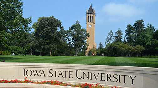 Photo of Iowa State University sign with Camponile among trees